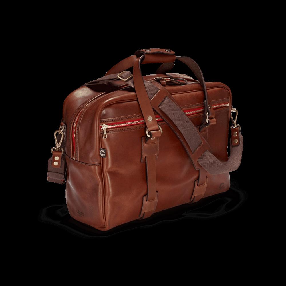 Die attraktive Reisetasche vintage leder Traveller im Vordergrund mit roten Reißverschlüssen